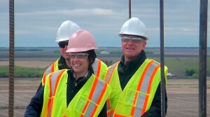 CWB's Ian White (right) and Dayna Spiring tour the construction of the new elevator at Glenlea, Man.