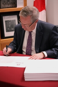 Chief Electoral Officer Marc Mayrand signs the writs for the 42nd general election.